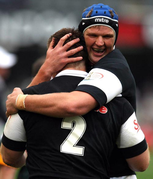 The Sharks' Johann Muller celebrates a try with team mate John Smit
