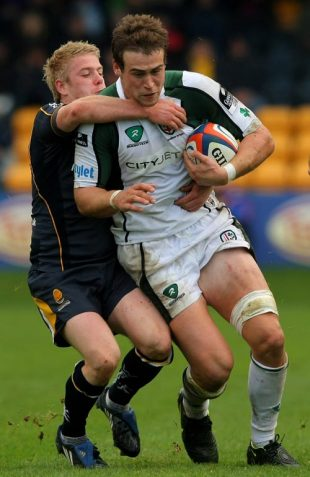 London Irish forward Jonathan Fisher is tackled by Worcester fly half Matthew Jones during the EDF Energy Cup Match between Worcester Warriors and London Irish at Sixways Stadium in Worcester, England on October 5, 2008.