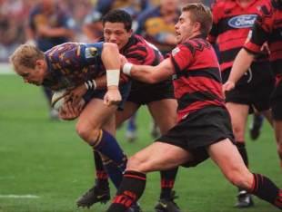 Jeff Wilson tries to break a Crusaders tackle