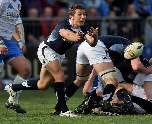 Scotland's Chris Cusiter spins a pass