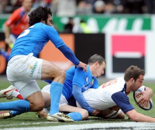 France's Alexandre Lapandry scores a try