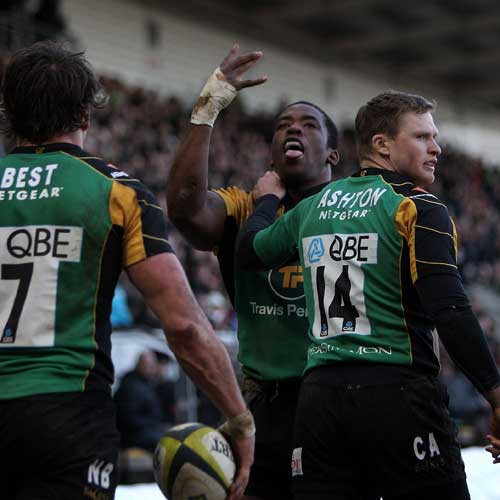 Northampton prop Brian Mujati celebrates his try