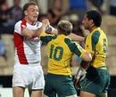 England's Tom Powell squares up to Australia's James Stannard and Kimami Sitauti