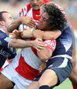 Tonga's Siaosi Iongi is wrapped up by the Scotland defence