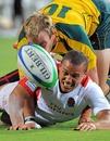 Australia's James Stannard tackles England's Dan Caprice