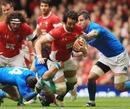 Three Italian defenders bring down Jonathan Thomas