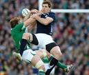 Scotland's Sean Lamont and Ireland's Stephen Ferris contest the high ball