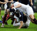 Thierry Dusautoir is brought down by Dylan Hartley and Danny Care