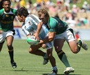 Argentina's Tomas Passerotti is tackled by South Africa's Frankie Horne