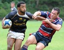 Mpho Mbiyozo of South Africa Sevens brekas a tacke during a practice match