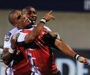 Wigan Pekeur celebrates his try with Tonderai Chavhanga