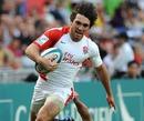 England's Mat Turner makes a break against Hong Kong