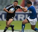 Wang Kuo-Feng is handed off by New Zealand's Zar Lawrence