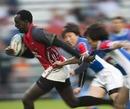 Humphrey Kayange leaves the Korean defence in a blur