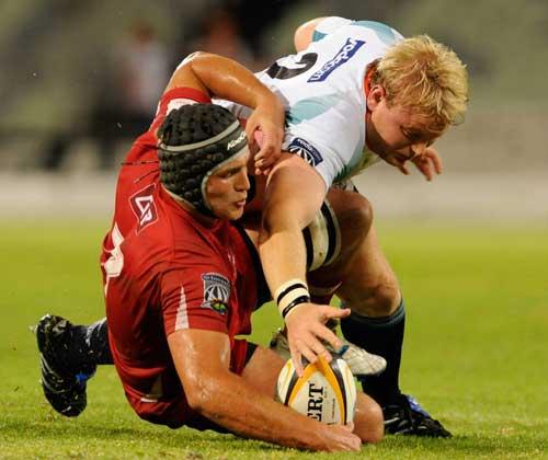 Cheetahs hooker Adriaan Strauss scraps with Reds flanker Jake Schatz for a loose ball