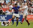 Samoa's Alafoti Fa'osiliva hands off a Russian tackler