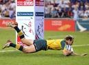Australia's James Stannard slides over against Canada