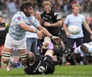 Lionel Nallet offloads while being tackled by Shaun Perry