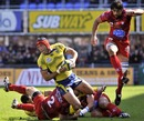Clermont's Alexandre Audebert looks for the offload under pressure from three Montpellier defenders