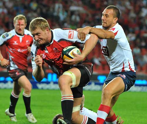The Lions'  Franco van der Merwe stretches the Reds' defence