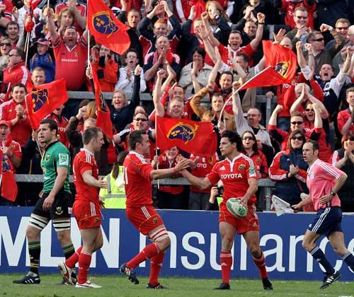 Munster's Doug Howlett is congratulated on scoring a try