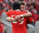 Munster's Ronan O'Gara and Lifeimi Mafi celebrate victory over Northampton