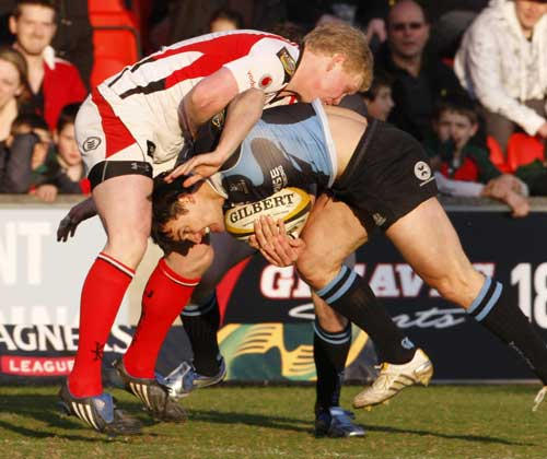 Glasgow's Max Evans is halted by Ulster's Paul Marshall