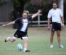 Sharks fly-half Andy Goode kicks under the watchful eye of coach John Plumtree