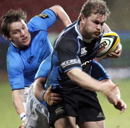 Glasgow's Fergus Thomson is held by the Leinster defence