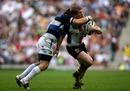 Wasps skipper Tom Rees feels the force of a Luke Watson tackle