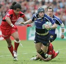 Leinster's Jamie Heaslip is felled by the Toulouse defence