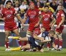 Brumbies scrum-half Josh Valentine stretches to score a try