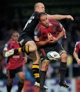 Cardiff Blues' Xavier Rush and Wasps' Mark van Gisbergen compete for a high ball