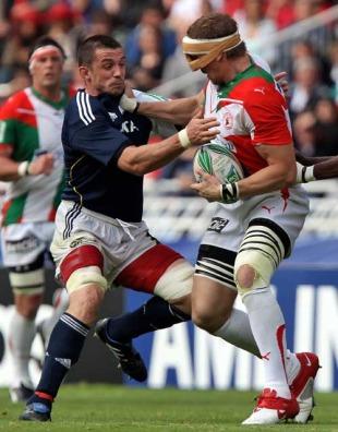 Biarritz's Imanol Harinordoquy fends off Munster's Alan Quinlan, Biarritz v Munster, Heineken Cup, Estadio Anoeta, San Sebastian, Spain, May 2, 2010