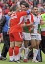 Biarritz coach Jean-Michel Gonzalez congratulates scrum-half Dimitri Yachvili