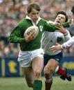 Ireland's Trevor Ringland on the attack