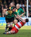 Northampton flanker Phil Dowson hands off Peter Buxton