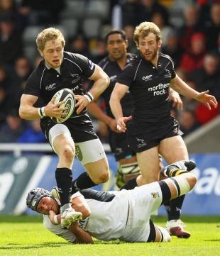 Newcastle's Alex Tait skips away from John Hart
