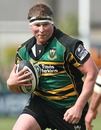 Northampton's Dylan Hartley takes on the Saracens defence