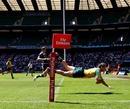 Australia's Clinton Stills dives in to score against Scotland