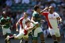 South Africa's Chris Dry hands off Tom Varndell
