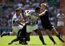 Samoa's Afa Aiono scraps against the New Zealand defence