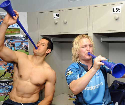 The Bulls' Pierre Spies and Dewald Potgieter celebrate winning the Super 14