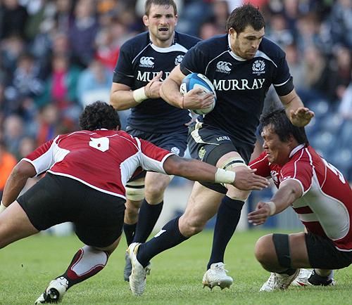 Scotland XV's Johnnie Beattie bursts through