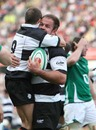 Barbarians skipper Xavier Rush is congratulated after scoring