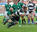 Barbarians skipper Xavier Rush dives in to score