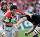 Biarritz flanker Wencelslas Lauret vies with Toulouse's defence