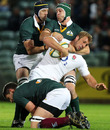 Stephen Hoiles tackles Chris Robshaw during the match between the Australian Barbarians and England