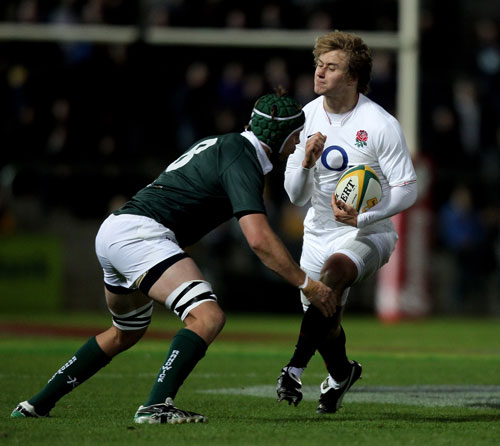 Stephen Hoiles tackles Matthew Tait during the match between the Australian Barbarians and England