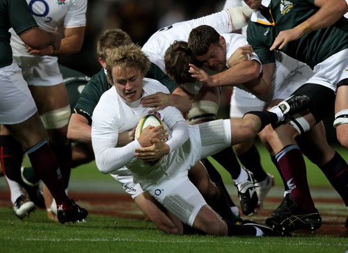 Matthew Tait is tackled during the match between the Australian Barbarians and England